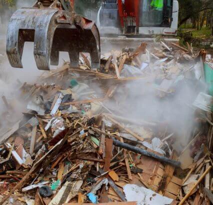 Bulldozer wrecking a building