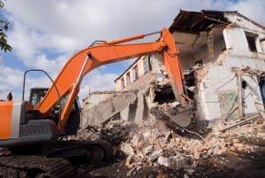 Tractor Demolishing a house