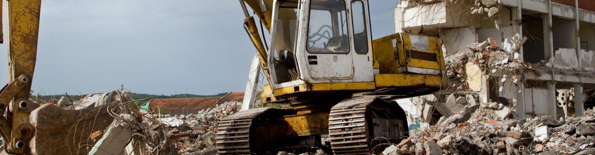 backhoe clearing on demolition site river ridge