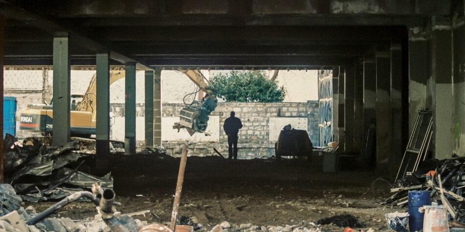 demolition contractor standing in demolition site