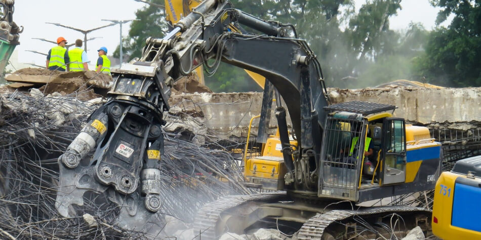 demolition contrators demolishing a structure using a bulldozer