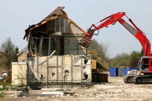 Excavator demolishing a building - Big Easy Demolition