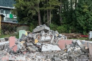 heap of broken bricks and concrete on demolition site - Big Easy Demotion