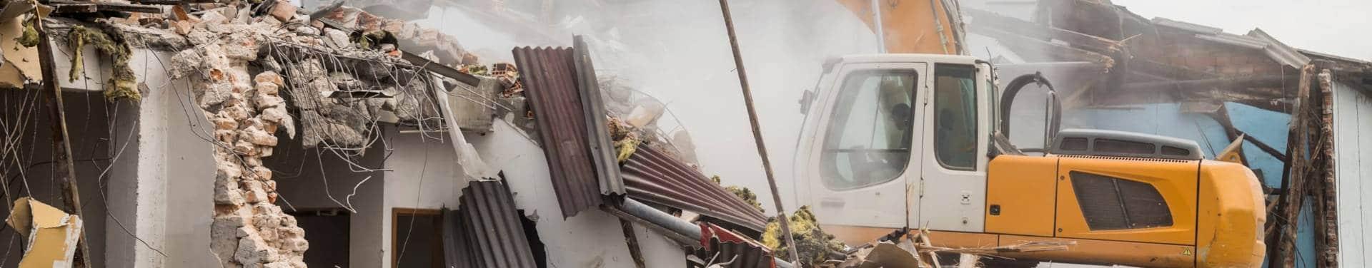 excavator demolishing a building in gretna la